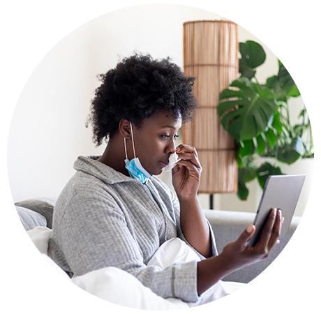 sick woman receiving medical advice from a doctor online via the doktorconnect app